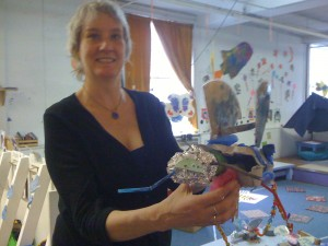 Ann proudly shows off one of the insects made by the Youngest Group